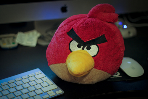 Angry Bird stuffed animal sitting next to keyboard for blog post: What is Anger? A Secondary Emotion