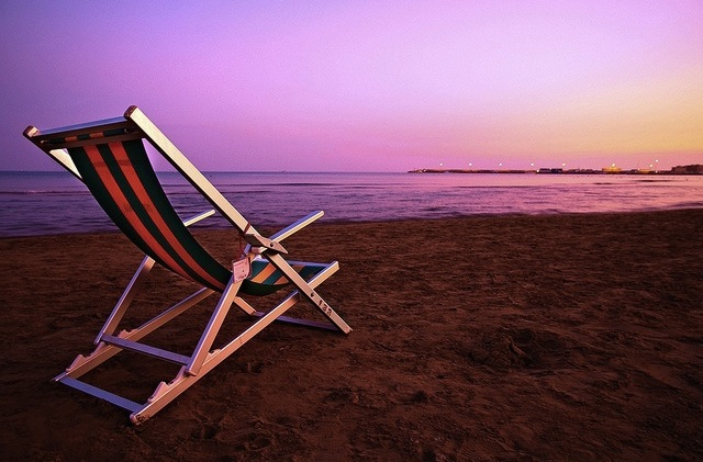 Empty chair on beach at sunset - great setting for inner peace