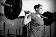 resilience as demonstrated by woman lifting weights